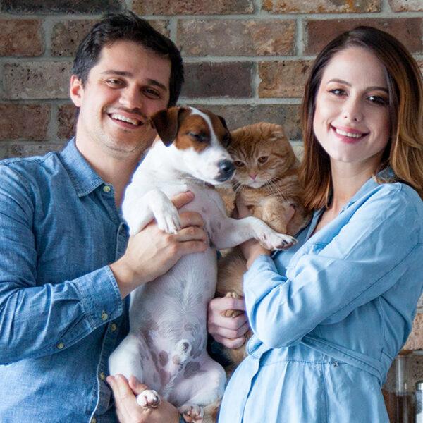 Man holding dog, pregnant woman holding cat